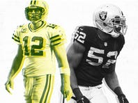 Packers QB Aaron Rodgers and Raiders DE Khalil Mack (52).