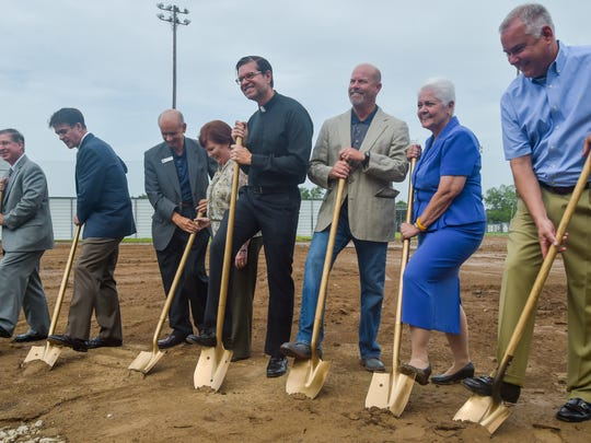 St. Thomas More Catholic High School holds a groundbreaking ceremony for a new 12-classroom addition.