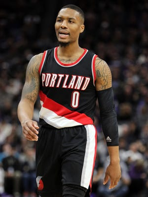 Portland Trail Blazers guard Damian Lillard (0) moved into the record books.