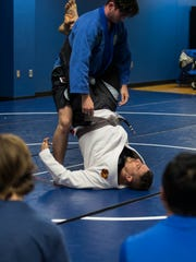 Ida Baker professor Josh Franzke demonstrates an exercise during his self defense class Tuesday afternoon. The teacher at Ida Baker High School started a self defense program for its students. The program is in its third year and provides a cross section of training for students including wrestling and jiujitsu among others.