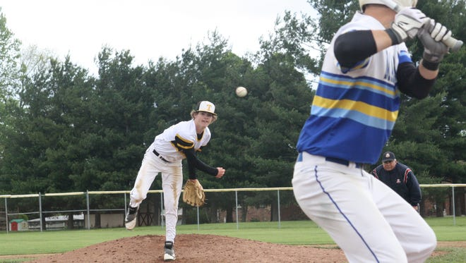 Taylor High School freshman pitcher Jacob Hughes delivers in a win over Madeira on May 14 at Harrison.