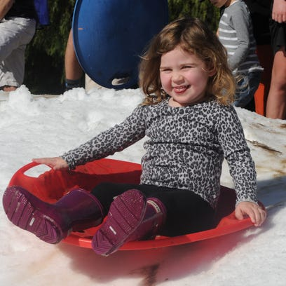 Cassidy Scott rides a saucer on 30,000 tons of snow