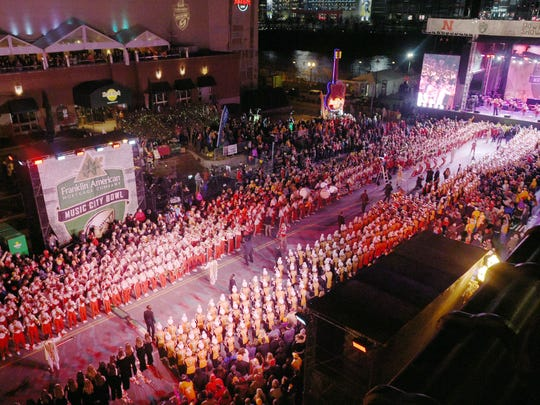 The Tennessee and Nebraska bands perform during the battle of the bands, part of Franklin American Mortgage Music City Bowl activities on Broadway on Thursday, Dec. 29, 2016.