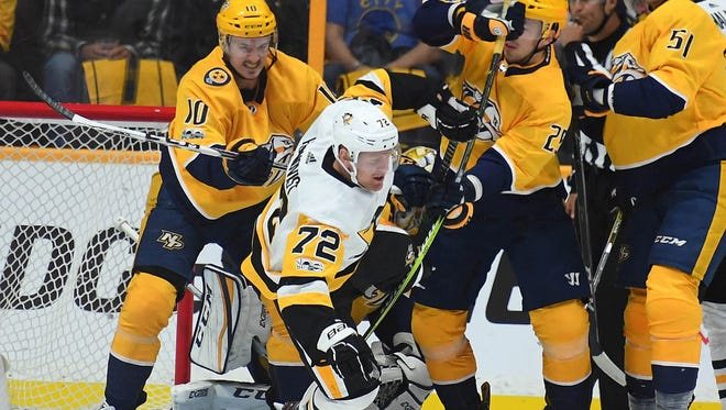 Nov 11, 2017; Nashville, TN, USA; Pittsburgh Penguins right wing Patric Hornqvist (72) is hit by Nashville Predators center Colton Sissons (10) in front of the net during the first period at Bridgestone Arena.