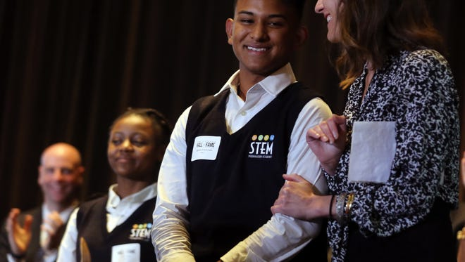Dr. Kristin McGraner congratulates Edgardo Enamorado as he receives a standing ovation for his testimony to the value the Nashville Newcomer Academy has provided to him and others after the program was awarded the Inspiring Innovation Award at the Nashville Public Education Foundation's annual luncheon held at the Omni Hotel Monday October 17, 2016.