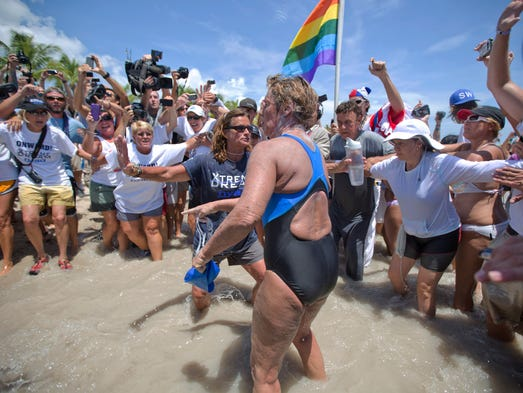Swimmer Diana Nyad, 64, is greeted by a crowd as she walks on to the Key West, Fla., shore, becoming the first person to swim from Cuba to Florida without the help of a shark cage.