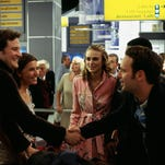 """Cast members from Universal Studios romantic comedy """"Love Actually,"""" from left, Colin Firth, Lucia Moniz, Keira Knightly and Andrew Lincoln appear in a scene at an airport, in this undated promotional photo."""