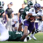 Junior defensive lineman Malik McDowell (4) and redshirt freshman cornerback Josh Butler (19) sack Northwestern quarterback Clayton Thorson during the game against Northwestern on Saturday, Oct. 15, 2016 at Spartan Stadium in East Lansing.