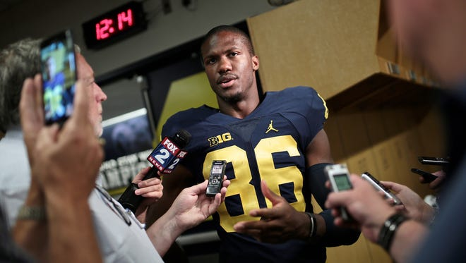 Michigan's Jehu Chesson (86) speaks to reporters during U-M media day Sunday, August 7, 2016, at Michigan Stadium in Ann Arbor.