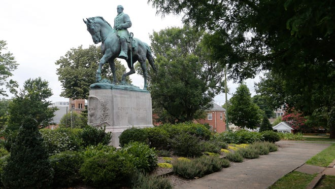 In this photo taken Aug. 14, 2017, the statue of Confederate General Robert E. Lee still stands in Lee park in Charlottesville, Va. Weeks before a statue of Robert E. Lee in Charlottesville, Virginia, became a flashpoint in the nation's struggle over race and history, it already was a focus of emotional debate in the state's Republican primary election.
