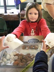 Rachel Hornburg, 8, passed out donuts during the Delafield Chamber's annual Breakfast with the Reindeer at the Delafield Fish Hatchery.