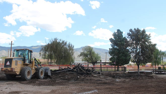 City crews work Saturday morning to remove the debris from Friday's fire which destroyed Kids Kingdom.