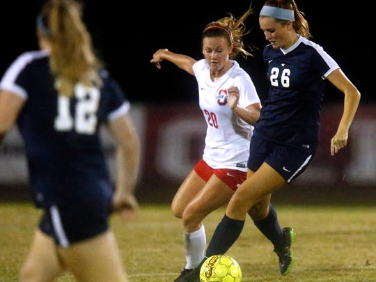OaklandÕs Caroline Smith (20) and SiegelÕs Monica Mullaney (26) both go after the ball during a soccer game, on Thursday, Sept. 14, 2017, at Oakland.