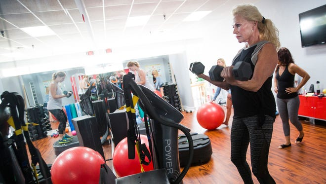 Mary Donaldson completes her reps on Thursday, Dec. 7, 2017, at BVibrant Naples Power Plate Studio in Naples. The vibrating plates incorporated into the workout are designed to intensify workouts by engaging muscles on every plane.