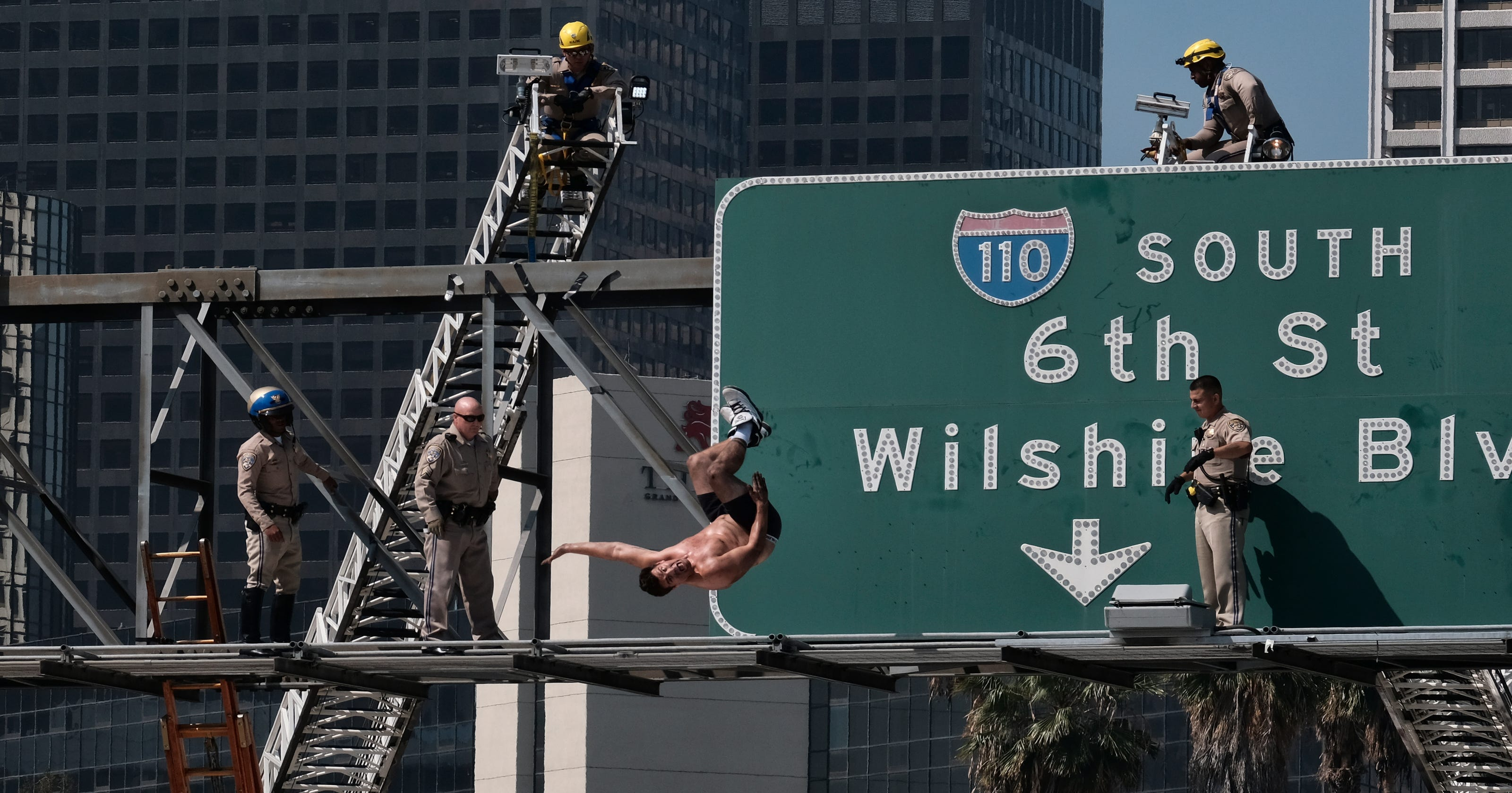 Nearly naked man on Los Angeles 110 freeway sign causes