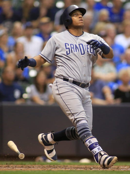 San Diego Padres' Yangervis Solarte hits a solo home run against the Milwaukee Brewers during the eighth inning of a baseball game Friday, June 16, 2017, in Milwaukee. (AP Photo/Darren Hauck)