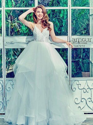 This dress, L'amour by Calla Blanche, is one of many dresses from several prominent brands carried by Christina Vail.