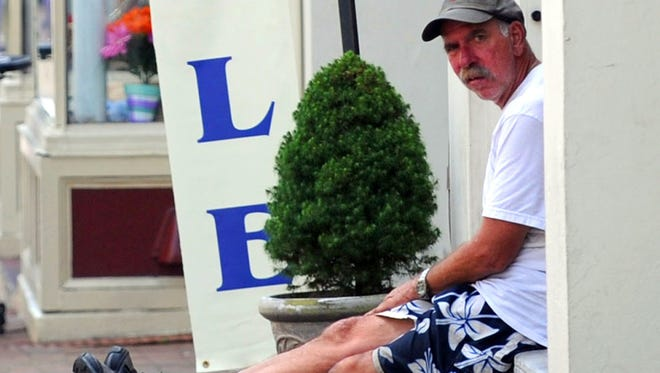Keith Alves sits on a stoop in front of a business on East Beverley Street in downtown Staunton on Tuesday, July 17, 2012.