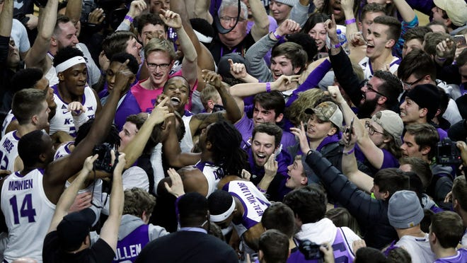 Kansas State players celebrate with fans following a win over Kansas in Manhattan, Kan., Tuesday, Feb. 5, 2019. Kansas State defeated Kansas 74-67.