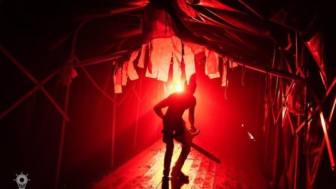 A performer makes his entry to Cirque Paranormal.