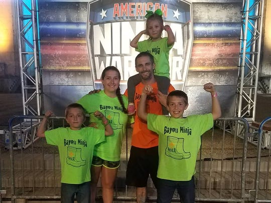 """Chris Cambre of New Orleans represents Louisiana on season 10 of NBC's """"American Ninja Warrior."""" He stands with his family where he competed in Texas."""