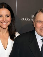 "Actress Julia Louis-Dreyfus and her father, William Louis-Dreyfus, at a screening of ""Generosity of Eye"" on May 27, 2014, in New York City."