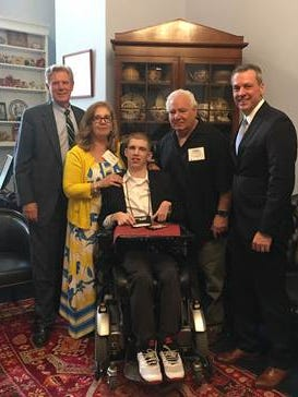 (Left to right) Frank Pallone, Nancy Panarese, Christian Panarese, Frank Panarese, and Warren E. Moore, president andCEO, Children's Specialized Hospital.