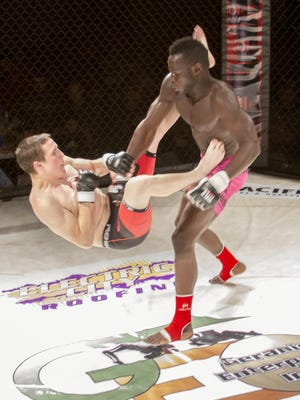 Johnson Nasona, right, slams Theron Martin to the canvas during a previous ICF event. ICF 29 comes to the Four Seasons Arena Friday, Oct. 20.