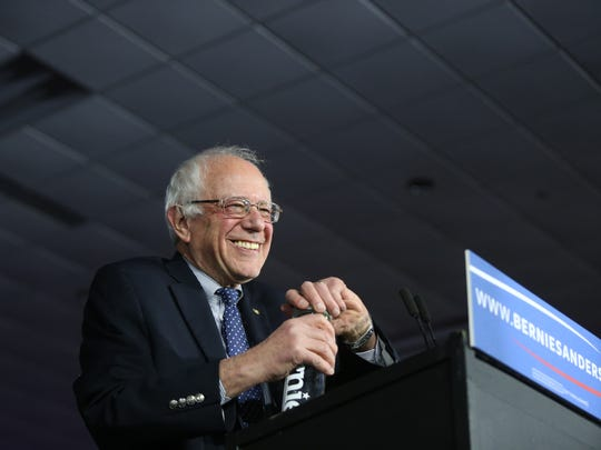 Vermont Sen. Bernie Sanders speaks to a crowd of supports on caucus night, Monday, Feb. 1, 2016, in Des Moines.