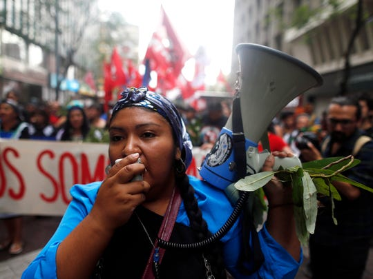 A Mapuche indigenous woman shouts slogans during a