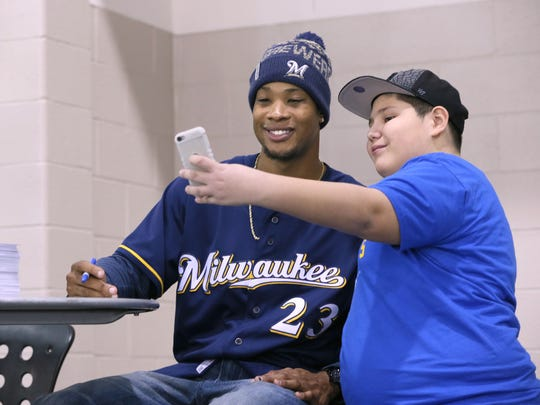 Xavier Bucio of Milwaukee (right) takes a selfie with Milwaukee Brewers outfielder Keon Broxton at Brewers on Deck last year. The 2018 edition is this Sunday at the Wisconsin Center.