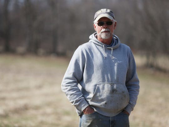 Chip Barrett in a field on his farm in Millerton on