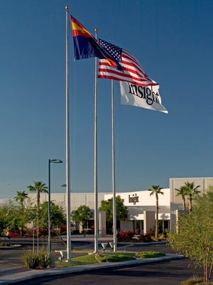 Flags outside Insight Enterprises corporate headquarters in Tempe, Ariz.
