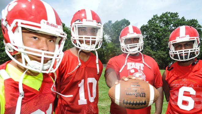 Cherry Hill East football players, from left, Sam Jeong, Garry Jackson, Devin Brown and Josiah LeBrun are hoping to take a step forward in 2016.