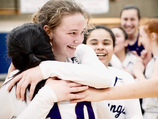 North Kitsap's Raelee Moore hugs a teammate after the VIkings beat Renton in a regional game Saturday at Rogers High School in Puyallup. With the win, the Vikings are headed to the state tournament in Yakima.