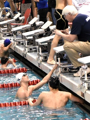 Justin Grender of St.Xavier looks up to his coach after winning the 50 Yard Freestyle at the SWDAB Boys Division 1 Swimming Tournement, February 17, 2018.
