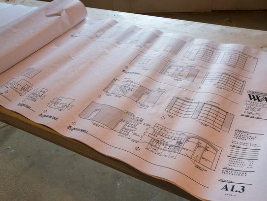 Blueprints showing the new glass and aluminum doors
