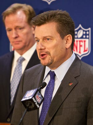 Arizona Cardinals President and Chairman of the NFL's new Conduct Committee, Michael Bidwill, speaks at an NFL press conference announcing new measures for the league's personal conduct policy during an owners meeting on Wednesday, Dec. 10, 2014, in Irving, Texas. At left is NFL commissioner Roger Goodell.