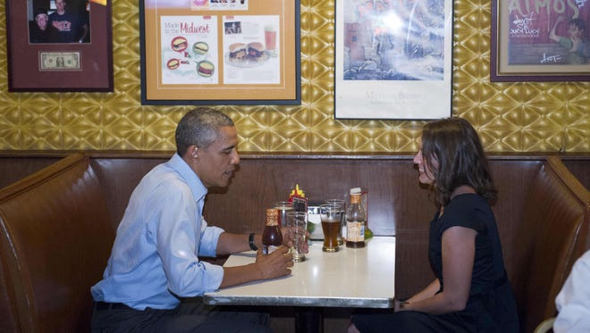 President Obama sits down for lunch in Matt's Bar with accountant Rebekah Erler.