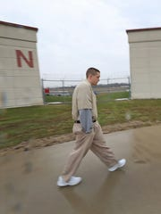 """Blake Layman, one of the """"Elkhart Four,"""" walks in the yard at Wabash Valley Correctional Facility in Carlisle, IN."""