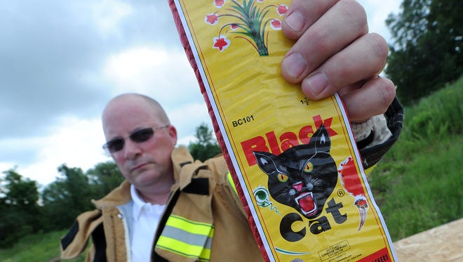 Fond du Lac fire chief Peter Oâ??Leary holds a package of firecrackers purchased local that he used in a demonstration on the physical and fire dangers posed by fireworks.