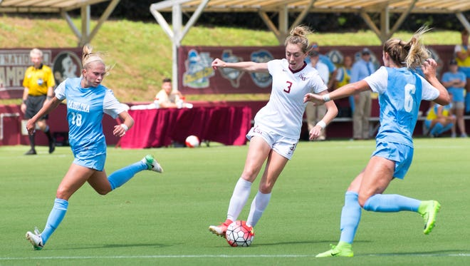 Florida State junior midfielder Megan Connolly (3) is surrounded by North Carolina's Megan Buckingham (18) and Taylor Otto (6) at the Seminole Soccer Complex on Sunday, September 17th.