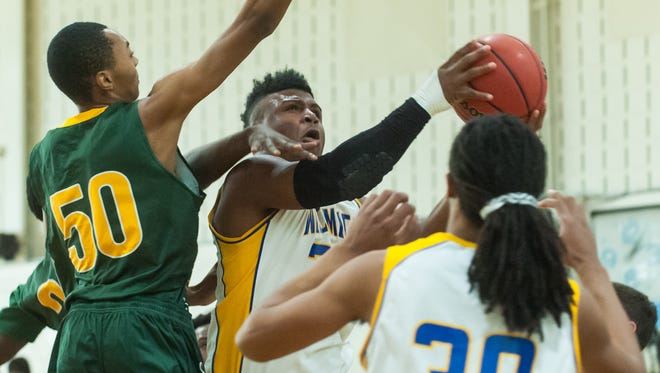 Wicomico guard Nelson Brown (20) takes a shot against Queen Anne's on Saturday afternoon in the Waller Dome.