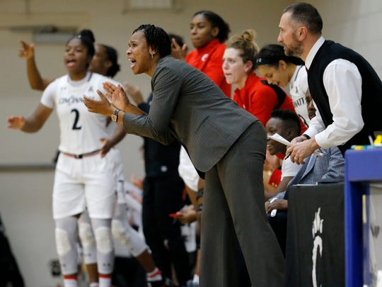 Bearcats head coach Jamelle Elliott directs her defense in the second quarter of the NCAA women's basketball game between the Cincinnati Bearcats and the Southeastern Louisiana Lions at St. Ursula Academy in the East Walnut Hills neighborhood of Cincinnati on Wednesday, Nov. 15, 2017. At halftime the Bearcats led 44-19.