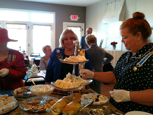 Charter anniversary Captain Henry Vanderburgh DAR Regent Heather Bryan Johnson serves Honorary Regent Cheri Baumberger and (left) Honorary Regent Rebecca Shelton at the 120th Anniversary of the Chartering of the Chapter in 1896.