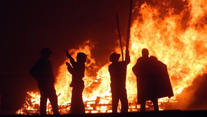 Revelers celebrate Bonfire Night on Sept. 25, 2004, in Burgess Hill, England.
