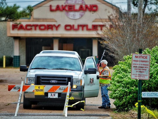 Surveyors with the Memphis-based firm A2H work April 6, 2016, where several empty shells are that remain of the Lakeland Factory Outlet Mall, where Gilad Development has made plans for luxury retail, a hotel, restaurants, office space and residences.