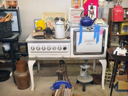 TORIN HALSEY/TIMES RECORD NEWS A vintage Hotpoint stove and other antique kitchen items are part of a wide variety of antiques at the Wichita Market.