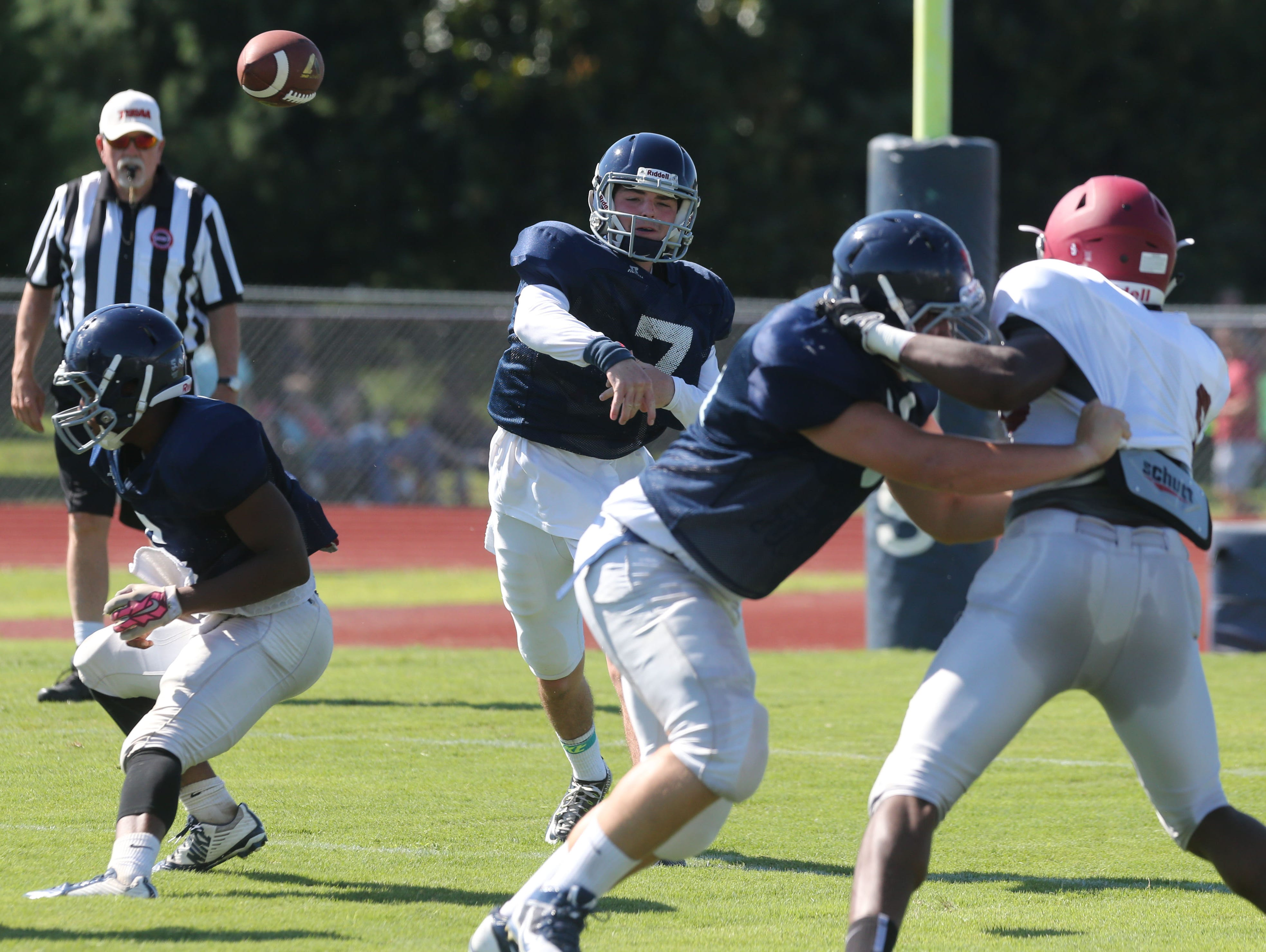Siegel's Jordan Middleton throws a pass against MBA on Friday.