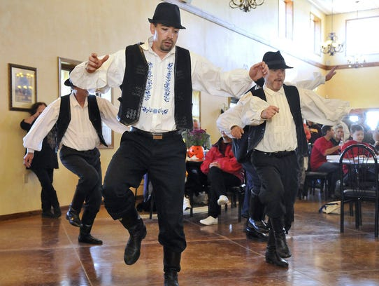 Hungarian folk dancers perform for the crowd at the